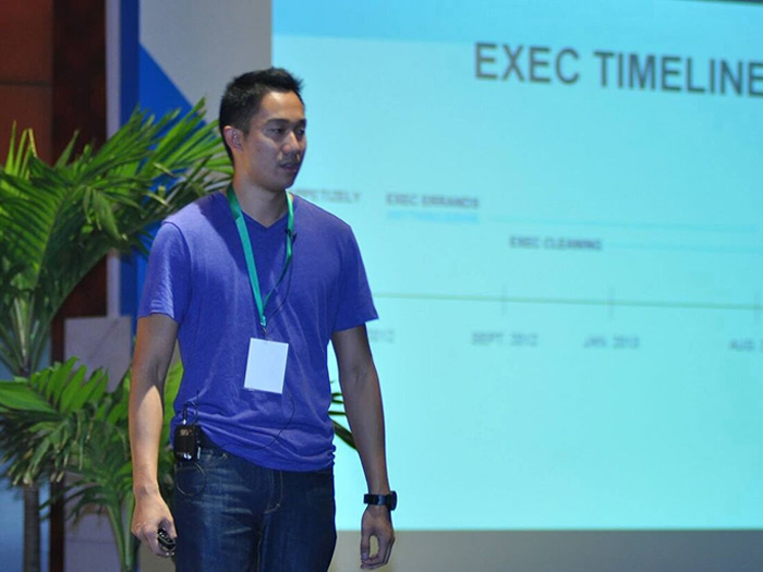 Dan speaking about Exec and entrepreneurship at a conference in 2014. Image credit: Daniel Kan