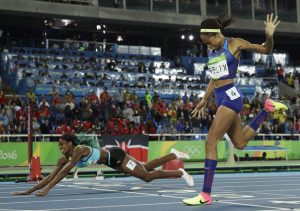 Bahamas' Shaunae Miller falls over the finish line to win gold ahead of United States' Allyson Felix, right, in the women's 400-meter final during the athletics competitions of the 2016 Summer Olympics at the Olympic stadium in Rio de Janeiro, Brazil, Monday, Aug. 15, 2016. (AP Photo/Matt Slocum)