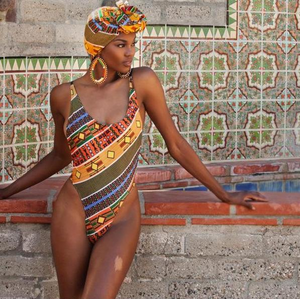 Eugena Washington poses in Ankara One Piece with matching headwrap set for Red Star Collection
